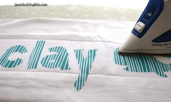 iron the design onto a burp cloth and topstitch around the design