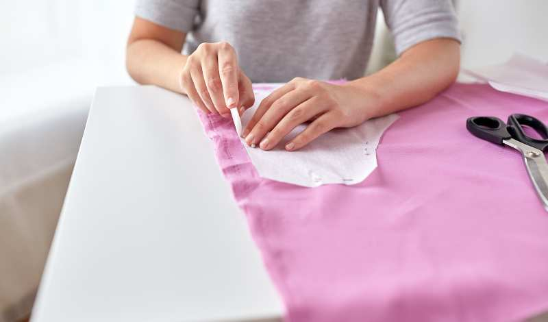 pin the fabric to one of your pattern pieces