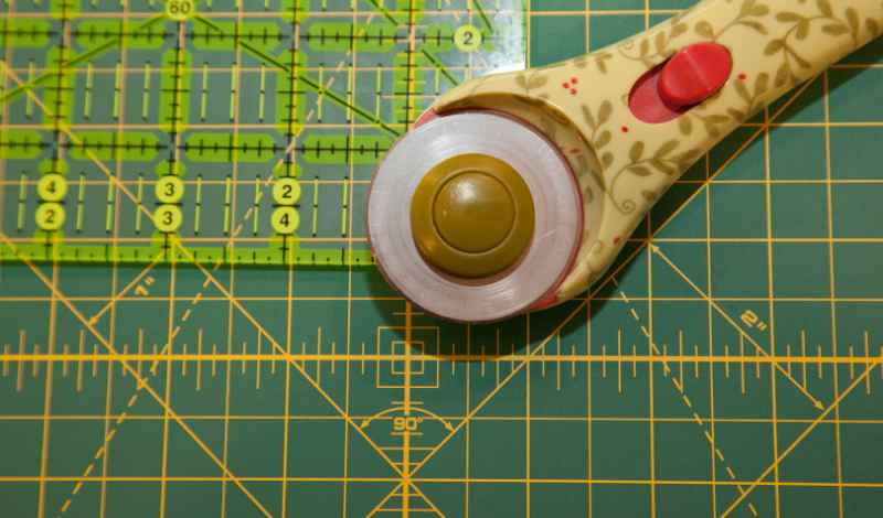 using a rotary cutter, cut excess fabric